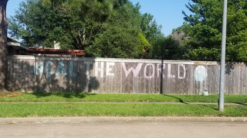 Heal the World chalk drawing on fence